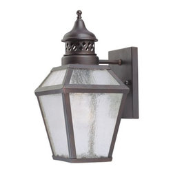 Savoy House - Chiminea Outdoor Wall Sconce No. 577213 by Savoy House - Crafted to mimic the appearance of an antique gas lantern, the Savoy House Chiminea Wall Sconce No. 577213 is a New Orleans-inspired outdoor light that features a rustic English Bronze finish and pale cream seeded glass. Perfect for homes needing a touch of colonial charm. Savoy House, headquartered in Braselton, Georgia, celebrates the uniqueness of today's decor styles by designing and manufacturing an extensive selection of high-quality ceiling fans and lighting fixtures for discerning homeowners.The Savoy House Chiminea Wall Sconce No. 577213 is available with the following:Details:Pale Cream Seeded glass shadeEnglish Bronze finishWall plateUL Listed for wet locationsLighting: One 60 Watt 120 Volt Incandescent lamp (not included).Shipping:This item usually ships within 3-5 Days.