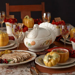 Holiday Dining - A celebration of the abundance that is autumn, Plymouth dinnerware features embossed pumpkins, acorns and ears of corn on a warm, creamy white surface. Sculpted acorn finials finish the lids of hollowware pieces. Platters and plates feature scalloped rims accented with gently flowing, weathered lines. A simple, lovely harvest pattern, Plymouth is ideal for Thanksgiving or any autumn occasion.