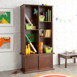 Classic Playtime - Classic Playtime Hopscotch Espresso Tall Bookcase with Optional Stackable Storag - Shop for Childrens Bookcases from Hayneedle.com! The Classic Playtime Espresso Tall Bookcase with Optional Stackable Storage with Sliding Door helps you keep books in order while adding understated style to your child's room. Durably constructed of MDF and wood veneers in a rich espresso finish this bookcase with a sliding door offers plenty of storage for books and other items. Perfect for any child's room with its simple finish and style this bookcase helps your little one start their very own library. Dimensions Stackable storage with sliding door only: 32L x 12.75W x 17H inches Tall bookcase only: 32W x 14.5D x 49.25H inches Tall bookcase and stackable storage with sliding door: 32W x 14.5D x 66.25H inches About Classic PlaytimePlaytime doesn't require batteries or a screen and providing kids with a place to grow and learn doesn't require sacrificing your home's integrity. Classic Playtime is devoted to the idea that given constructive ways to explore their world and themselves children blossom in their own gardens. Our furniture is designed to be simple unique and functional in both kids' and adults' spaces. You'll find stylish and practical places for art activities reading writing building and somewhere to keep it all during downtime.