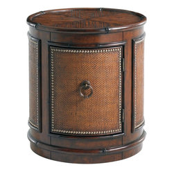 Lexington - Tommy Bahama Home Landara Sandpiper Round Lamp Table - With a sophisticated mix of materials, this piece features a crushed bamboo top with rattan trim throughout, as well as curved panels of woven raffia with decorative nail head trim and custom designed hardware in an antiqued brass patina. The door opens to the right, revealing an adjustable shelf inside.