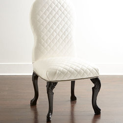 """Old Hickory Tannery - Sydney Dining Chair - WHITE LEATHER - Old Hickory TannerySydney Dining ChairDetailsEXCLUSIVELY OURS.Hardwood frame.Vinyl (polyurethane/cotton/polyester) upholstery with allover diamond quilting.Nailhead trim.Finished back.23""""W x 26.5""""D x 47""""T; seat 19""""D x 21.5""""T.Made in the USA.Boxed weight approximately 55 lbs. Please note that this item may require additional shipping charges.Designer About Old Hickory TanneryFounded more than 30 years ago Old Hickory Tannery is still family owned and operated in Hickory North Carolina. Although the company's name reflects its original focus on fine leather upholstery Old Hickory is now equally well know for fabric-covered seating. Its range of styles is impressive from dramatic Duncan-Phyfe-style sofas to graceful Queen Anne armchairs claw-footed tub chairs feminine full-skirted settees and sleek slipper chairs. Old Hickory's craftsmen bring an abundance of expertise to their work; some have been making furniture for almost half a century. All upholstery is cut and sewn entirely by hand all frames are solid hardwood nailhead trim is hand-hammered and all springs are hand-tied to the frame and surrounding springs at eight points for lasting comfort and stability. These are just a few of the reasons why this American furniture maker is one of our favorites."""