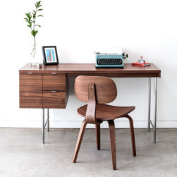 Modern Home Office - The Gus Modern Conrad Desk is a compact home office desk with a strong Mid-Century pedigree. All surfaces are finished in walnut, to contrast the slender, tubular stainless steel legs and drawer pulls. The main drawer is designed to hold hanging file folders, and the two smaller drawers are perfect for organizing stationary and supplies. This desk evokes the style of 1950s Modernism, but with a scale and functionality suited perfectly for today.