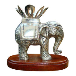 """Consigned Antique Sterling Silver Indian Anglo Raj Carved Elephant - A rare beauty, this antique sterling silver indian anglo raj carved elephant features a twist off candle holder top, wood base and 1940s sterling silver body. The seller will obtain jeweler's authentication for buyer. Antique Sterling Silver Indian Anglo Raj Carved Elephant Twist Off Candle Holder Top, Wood Base / 1940s Sterling Body Length: 5.25"""" X Height: 5 & 3/8"""" X Width: 3.5"""" ,Teak Base Length: 6 & 7/8"""", Total Weight 3 Lbs .7 Oz"""