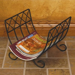 J & J Wire Wrought Iron Magazine Rack - Whether you use the J & J Wire Wrought Iron Magazine Rack to store wood next to the fireplace or magazines next to your recliner you're guaranteed to have a cozy relaxing evening. With its simple elegant design this versatile rack can be used almost anywhere you need to store a stack of something but don't want an untidy pile on the floor. This rack is proudly made in the USA from wrought iron with a black powder-coat finish. About J & J Wire Inc.Located at the Industrial Park in Beatrice Nebraska J & J Wire Inc. started 25 years ago as a wire-forming business manufacturing mostly houseware items. Since then the company has grown into a metal fabrication business serving customers in many different manufacturing sectors in the United States and Canada. From quilt racks to wine racks J & J Wire is committed to creating handmade works of art at affordable prices.