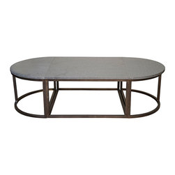 Oval Stone Coffee Table with Metal - A dark slab of stone serves as a field for tablescape display or simply a rounded open space for increasing the inviting nature of your furnishing arrangements.  The Oval Stone Coffee table is lustrous yet rich in patina, simple yet opulent, dark yet eye-catching; the metal bars which are bent to form its curved base display a warm brushed metal hue.  Use with traditional furnishings for a roomy look or with updated pieces for a sleek completeness.