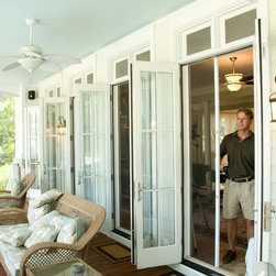 Retractable Screens - Retractable screen door installation on double door opening.