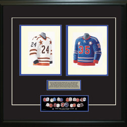 """Heritage Sports Art - Original art of the NHL 1970-71 NHL All-Star jersey - This beautifully framed piece features two pieces of original, one-of-a-kind artwork. Both images are glass-framed in an attractive two inch wide black resin frame with a double mat. The outer dimensions of the framed piece are approximately 28"""" wide x 24.5"""" high, although the exact size will vary according to the size of the original art. At the core of the framed piece is the actual piece of original artwork as painted by the artist on textured 100% rag, water-marked watercolor paper. In many cases the original artwork has handwritten notes in pencil from the artist. Simply put, this is beautiful, one-of-a-kind artwork. The outer mat is a rich textured black acid-free mat with a decorative inset white v-groove, while the inner mat is a complimentary colored acid-free mat reflecting one of the team's primary colors. The image of this framed piece shows the mat color that we use (Medium Blue). Beneath the artwork is a silver plate with black text describing the original artwork. The text for this piece will read: This is an original watercolor painting of the 1970-71 Blue NHL All-Star jersey and a reproduction of the 1970-71 White All-Star jersey. These jersey images have been, and continue to be, used to celebrate the history of the NHL All-Star game in posters like the one shown below as well as game programs, magazines and websites across North America. Beneath the silver plate is a 3"""" x 9"""" reproduction of a well known, best-selling print that celebrates the history of the team. The print beautifully illustrates the chronological evolution of the team's uniform and shows you how the original art was used in the creation of this print. If you look closely, you will see that the print features the actual artwork being offered for sale. The piece is framed with an extremely high quality framing glass. We have used this glass style for many years with excellent results. We package every piece"""