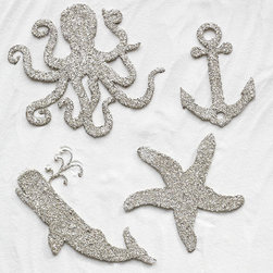 Nautical Glitz Ornaments - As a lover of all things nautical, I fell head over heels for these glitzy ornaments from Wisteria. Pull them out next summer, and you'll have gorgeous place card holders for a dinner party.