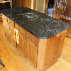 Soapstone Countertop, Wadsworth, Ohio #1 - In this existing kitchen, we assisted the home owner in upgrading their countertop, backsplash and cabinet hardware to update their kitchen.  New Pro Value Satin Nickel knobs and pulls were installed on the existing cabinetry.  Brazillian Soapstone with double roundover edge profile was installed on the countertop perimeter and island.  A Swan Granite large/small bowl undermount sink in Nero  with a Moen Motionsense single-handle pull down faucet in stainless was installed.  For the backsplash, Brown Travertine Tumbled Limestone Tile in Roman Pattern with 1x12 Pencil Liners and 1x8 Decorative Glass Tiles in Tweed was installed.