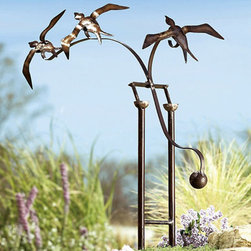"""Birds in Flight - This see-saw sculpture must be mesmerizing to watch in action. I love the idea of watching the birds """"flying"""" up and down out of a bed of wildflowers. The bronze finish should acquire a nice patina over time which would add to the effect."""