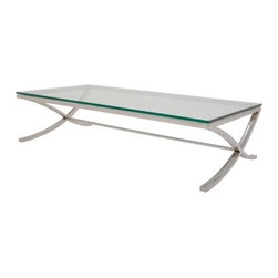 Nuevo Felix Coffee Table - The Nuevo Felix Coffee Table takes elements of the old and twists them into something distinctly contemporary not to mention totally awesome. This piece is constructed from durable stainless steel for a structure you can count on. Polished to a glorious gleam the frame features two curved intersecting legs at either end joined by a central beam for extra support. To top this piece off is a clear glass table top tempered for added strength. With the best of the modern and a dash of the traditional this piece will prove to be timeless. This table measures 48W x 24D x 15H inches.About NuevoOne of the most exciting contemporary design companies in the market Nuevo has made a name for itself with its unique approach to professional-quality home furnishings. Creating pieces with a thoroughgoing contemporary edge Nuevo never fails to make a fashionable statement of the highest construction value.