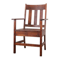 Pre-owned Antique Mission Style Chair - An antique mission style chair from the 1920s.  Solid wood chair with a light brown finish. The chair features Arts and Crafts style wood slats on the back, and features wide arm rests. On the back slat of the chair, there are two small holes. These were possibly used for hanging the chair or remnants from and old name plate.  The wood is naturally aged, and there are a few minor scratches. The seat height is 17.5 inches. Bring this chair into the modern age with a hip geometric throw or sheepskin!