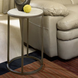 """Hammary - Modern Basics Round End Table in Natural Travertine/Textured Bronze Finish - """"Spice up your living room with a collection that offers style for modern living. This occasional table collection consists of a combination of Natural Travertine and Bronze metal for a sleek, contemporary look. Featuring simple silhouettes of circles, rectangles, and squares, you can be sure that this collection can fit in with just about any style decor. Simple, straight lines make up the leg supports, while a simple palette of travertine makes up the table tops. What a wonderful way to bring in an element of modern living."""