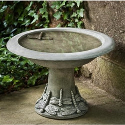 Campania International Dragonfly Cast Stone Bird Bath Small - About Campania InternationalEstablished in 1984, Campania International's reputation has been built on quality original products and service. Originally selling terra cotta planters, Campania soon began to research and develop the design and manufacture of cast stone garden planters and ornaments. Campania is also an importer and wholesaler of garden products, including polyethylene, terra cotta, glazed pottery, cast iron, and fiberglass planters as well as classic garden structures, fountains, and cast resin statuary.Campania Cast Stone: The ProcessThe creation of Campania's cast stone pieces begins and ends by hand. From the creation of an original design, making of a mold, pouring the cast stone, application of the patina to the final packing of an order, the process is both technical and artistic. As many as 30 pairs of hands are involved in the creation of each Campania piece in a labor intensive 15 step process.The process begins either with the creation of an original copyrighted design by Campania's artisans or an antique original. Antique originals will often require some restoration work, which is also done in-house by expert craftsmen. Campania's mold making department will then begin a multi-step process to create a production mold which will properly replicate the detail and texture of the original piece. Depending on its size and complexity, a mold can take as long as three months to complete. Campania creates in excess of 700 molds per year.After a mold is completed, it is moved to the production area where a team individually hand pours the liquid cast stone mixture into the mold and employs special techniques to remove air bubbles. Campania carefully monitors the PSI of every piece. PSI (pounds per square inch) measures the strength of every piece to ensure durability. The PSI of Campania pieces is currently engineered at approximately 7500 for optimum strength. Each piece is air-dried an