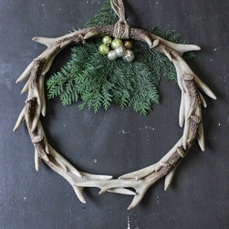 Decorative Antler Wreath - Celebrate the natural world this holiday and all year with this resin-constructed antler wreath. A striking addition on your front door or hanging in a window, its handsome and unique texture radiates soft, natural charm.