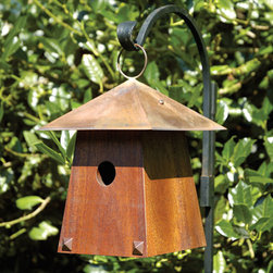 Avian Bungalow Hanging Bird House - Mahogany - The gently sloping body, topped with a hand burnished copper roof, and the Bronze nail heads give this bird house a Craftsman style. Features a large hanging loop and copper cleanout door in the back.