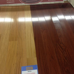 Solid wood - Premium Ciara High Gloss Oak Floors. Available in five colors. Shown here Red Oak Natural and Cherry