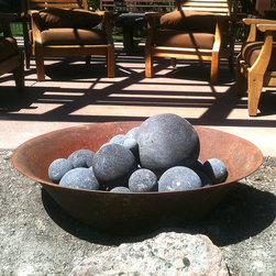 Iron Rice Cooker Fire Pit - This heavy, old iron rice cooker form central Java, Indonesia, makes the perfect fire pit.  The natural gas burner was custom made by a local fireplace company and the lava stone balls hide the burner, but also retain the heat.  A beautiful addition to any backyard.