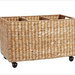 """Savannah Recycle Bin Basket - Woven by hand of natural, sustainable seagrass, our wheeled recycling bin has a rich, textural look. Two removable dividers make it easy to sort bottles, cans and paper goods. 23"""" wide x 13"""" deep x 15"""" high Handwoven of natural seagrass with plastic casters. Savannah is the lighter stain"""