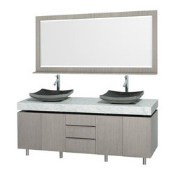 "Wyndham Collection(R) - Malibu 72"" Double Bathroom Vanity Set by Wyndham Collection - Gray Oak Finish wi - The Malibu 72"" Double Bathroom Vanity Set in Espresso finish is one of the newest additions to the Wyndham Collection Designer Series by Christopher Grubb. It stands tall among contemporary bathroom vanities and demands the attention modern bathroom design evokes. This amazing comes complete with ample storage space and statement making counter. Its thick marble counter expand the glamour and modern design of this vanity, and will transform your bathroom into a contemporary masterpiece. Each counter is custom made with abundant marble facing in White Carrera or CaesarStone (also available in Ivory Marble). This is a Wyndham Collection original design, and is therefore only available in very limited numbers. Incredibly, this price is for the vanity, sinks, mirror and FREE SHIPPING! Counters are pre-drilled for single-hole faucets. Please contact us for 3-hole faucets. Also available with an Ivory Marble Counter. Features Constructed of beautiful natural wood veneers over solid oak hardwood Cutting edge, unique styling by Interior Designer Christopher Grubb 8-stage painting and finishing process Floor-standing vanity Fully-extending under-mount soft-close drawer slides Deep doweled drawers Soft-close concealed doors hinges Single-hole faucet mount Faucets not included Brushed Steel finish legs and counter supports Stunning custom-ordered natural marble ""floating"" 4"" deep counter Includes choice of porcelain or optional granite vessel sinks Includes matching mirror 4 doors, 3 drawers How to handle your counter Spec Sheet for vanity Installation Guide for Countertops with Vessel Sinks Installation Guide for Undermount Sinks --> Stone Vessel Sink Installation Guide Installation Guide for MirrorsSpec Sheet for Rotating Wall Cabinet with mirror (WC-V02) Spec Sheet for Wall Cabinet (WC-V203) Spec Sheet for Wall Cabinet (WC-V205) Spec Sheet for Wall Cabinet (WC-V207) Installation Guide for WC-V207 Please note that all custom natural stone and Caesarstone counters are proudly manufactured in the USA specifically for your order, and so require up to 3 weeks manufacturing time. Caesarstone Carbone, Starry Night, Spring Blossom, and Marrone are made from recycled content. Quartz Reflections and Ruby Reflections colors are made with up to 35% post-consumer recycled glass. Chocolate Truffle color is made with up to 17% post-consumer recycled glass.Natural stone like marble and granite, while otherwise durable, are vulnerable to staining from hair dye, ink, tea, coffee, oily materials such as hand cream or milk, and can be etched by acidic substances such as alcohol and soft drinks. Please protect your countertop and/or sink by avoiding contact with these substances. For more information, please review our ""Marble & Granite Care"" guide."