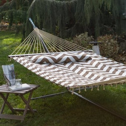 Island Bay 13 ft. Cafe and Cream Chevron Stripe Quilted Hammock - Soak up the sun in the Island Bay Café and Cream Chevron Stripe Quilted Hammock. The soft quilted bed and matching button-on pillow provide ultimate comfort. The hardwood spreader bars ensure a graceful entrance and exit, keeping the bed open. There's no need to worry about the fabric fading, as it's treated to be weather-resistant and will hold up to sun and rain. This hammock includes all hanging hardware, so you'll be off your feet in minutes!About Island Bay HammocksIsland Bay brings you well-designed, authentic hammocks and accessories from around the world. From the East Coast to the West Indies, the hammock is recognized as the ultimate getaway, so we've dedicated ourselves to getting it right. You'll find eye-catching colors and patterns, comfortable outdoor designs, and heavy-duty stands designed to keep you swinging peacefully. It's your world ... relax in the real thing.