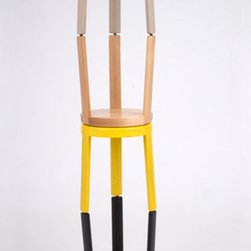 Swedish baby stools stacked - The Swedish Baby series of stools is a take on the classic three-legged wooden stool. The side assembly of the legs reveals a delicate connection detail, while the formal language is a play on the tension between the sharp and the soft. Available in table height, counter height and bar height.