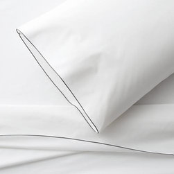 Belo Grey Extra-Long Twin Sheet Set - Clean, basic white bedding upgrades in soft, smooth cotton percale, beautifully contrasted with a graceful grey overlocking stitch on the flat sheet and pillowcase. Generous fitted sheet pockets accommodate thicker mattresses. Sheet set includes one flat sheet, one fitted sheet and two pillowcases. Bed pillows also available.