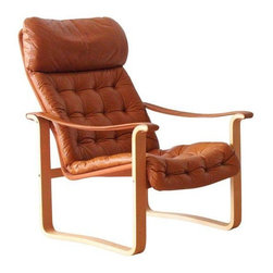 Highback Dahlqvist Finland Leather Lounge Chair - This chair is the only one for us! Designed by Oy B.j. Dahlqvist AB for BD Furniture Finland in the '70s. With nice minimal lines, it is light weight and not too bulky for apartment spaces. Get in ready lounging position, folks, because the bent wood frame suspends a very comfortable tan leather, tufted sling back seat and arm rests. Kiss your social life bye-bye because we just introduced to you to your new best friend!