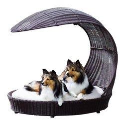 Outdoor Dog Chaise Lounger - When you're hanging out by the pool, your furriest friends can be relaxing right along with you. Place this waterproof dog bed on the patio for a cozy and stylish addition to your lounge furniture. At the end of swim season, simply toss the pillow in the washing machine and it'll be ready for the next sunny day.