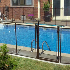 Traditional  by Pool Guard Of Ohio