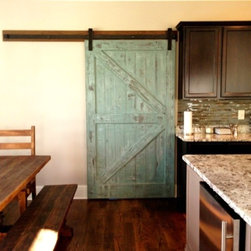 Barn Doors - This unique sliding barn door is made of hand-selected reclaimed Oak circa 1800s. The antique wood is character rich and retains its original nail holes, knot holes, checks and voids. Handcrafted in the stile and rail tradition, this door uses rabbit joint construction with inset vertical panels made of vintage bead board painted in a modern turquoise blue and then distressed.