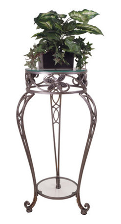 Welcome Home Accents - Dragonfly Plant Stand - Round indoor metal plant table features glass bottom shelf and glass top, along with hand inlaid bejeweled dragonflies.  Intricate metal curves with antiqued nickel finish.  Durable metal frame.  Some assembly required.  Dust with a dry cloth.