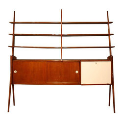 Used Italian Freestanding Wall Unit or Room Divider - This 1950s Italian Freestanding Wall Unit/Room Divider is in the style of Ico Parisi. it comes with the key that opens the cabinet to the far right. Additionally, there are two sliding doors that reveal shelves and interior storage. The piece is in good, vintage condition showing age-appopriate wear.