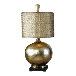 Uttermost Julian Champagne Leaf Table Lamp - Glass body with an antiqued silver/champagne leaf finish on the inside. This glass lamp is finished from the inside with an antiqued silver/champagne leaf and cast aluminum accents. The round drum shade is constructed from small spirals, hand forged out of wire with an antiqued silver finish and a silken champagne inner liner.