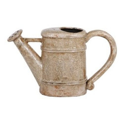 Privilege International Cream Ceramic Garden Watering Can - The Privilege International Cream Ceramic Garden Watering Can is brilliant in its simplicity. This ceramic watering can conjures images of the past. The distressed finish gives it the look and feel of a treasured relic. Use it as decoration, or plant flowers in the rear opening. It's versatility, beauty, and durability in one package.