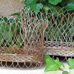Home Decorators Collection - Nested Wire French Baskets - Set of 2 - Fashioned with rustic yet sophisticated styling, our set of two Nested Wire French Baskets will complement a variety of home decor styles. Display the bowls on an entryway table, buffet or sofa table for added appeal. Set of 2. Made of metal.