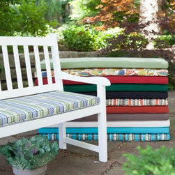 Coral Coast 45 x 18 Outdoor Cushion for Benches and Porch Swings - Add a new level of comfort and a little visual appeal to your outdoor furniture with a Coral Coast 45 x 18 Outdoor Cushion for Benches and Porch Swings. Two ties will keep this cushion securely attached to your favorite bench or swing and piped edging gives it stylish finished look. Each cushion is filled with polyester fiber filling for softness and durability. We recommend spot cleaning with soap and water when necessary. Please measure your furniture carefully before ordering and because of their hand-crafted construction please allow for a .25-inch variance. Measure before you orderYou should measure your outdoor furniture carefully before ordering to ensure a proper fit. Measure the width of your seat from side to side between the arms. Measure the depth or length from the front of the seat to the back of the seat. Care and MaintenanceThese cushions are designed for outdoor use but in order to prolong the life of the cushion we recommend that you bring it in or protect it from the elements when not in use. All fabrics are treated to resist mildew. However mildew is made by the presence of dirt combined with the prolonged exposure to moisture without proper drying. A regular cleaning program consisting of hosing down the cushions and allowing them to completely dry in open air and sunlight will enhance the appearance and life of the cushions. Spot-clean stains with a mild detergent and water solution. About Coral CoastWhat if when you closed your eyes you pictured yourself in your own backyard? Coral Coast has a collection of easygoing affordable outdoor accessories for your patio pool or backyard. The latest colors and styles mingle with true classics in weather-worthy fabrics and finished woods ready for relaxation. Make yours a life of leisure.