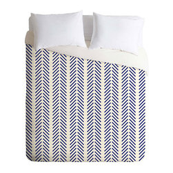Sequential Chevron Duvet Cover - Nautical colors greatly enhance the appeal of this Sequential Chevron Duvet Cover. Designed for simplicity and style, this duvet cover offers a bright white background with vertical stripes of angled lines that combine to create a chevron pattern. The navy lines add movement and dimension to the minimalist appeal of this striking duvet cover. Adding a hidden zipper and interior ties makes it easy to keep your duvet insert in its proper place.