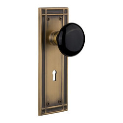 Nostalgic Warehouse - Nostalgic Mission Plate with Black Porcelain Knob and Keyhole in Antique Brass - The Mission plate in antique brass harkens to the Spanish Colonial period of the Western frontier, with an instantly recognizable square corner. Add our timeless, kiln-fired Black Porcelain Knob to create a sophisticated, yet classic look. All Nostalgic Warehouse knobs are mounted on a solid (not plated) forged brass base for durability and beauty.