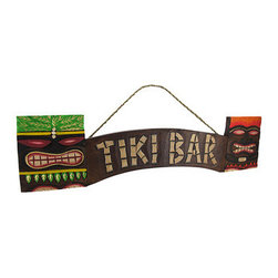 Wooden `Tiki Bar` Sign with Tiki Masks 23 In. - This wooden `Tiki Bar` sign adds the perfect accent to beach restaurants, bars, patios, and more. It is hand crafted from Indonesian Albesia wood and features a cool tiki face on either end. It measures 23 inches long, 5 3/4 inches tall, 3/4 of an inch deep and has a twisted rope hanger. It is a wonderful accent above a doorway, or is the finishing touch for your home tiki bar.