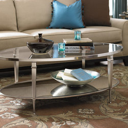 Hammary Mallory Collection - Oval Coffee Table - This transitional living room incorporates contemporary and traditional elements to create a harmonious design. A neutral color palette is accented with turquoise throw pillows and the mirrored oval coffee table by Hammary Furniture offers both style and function.
