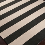 Rain Stripe Rug - Espresso - Broad stripes of your chosen color alternate with a neutral parchment hue in the transitional Rain Stripe Rug, a luxury floor covering for d�cor in a range of styles from nautical to minimalist to global.  This area rug's medium pile feels rich underfoot.  Traditionally hand-hooked and crafted from quality synthetic fibers to endure use outdoors or in, the rug comes in lush Carnelian red, charming Stormy Sea blue, burnt Espresso and quiet Sage Green.
