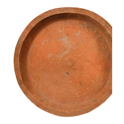 "Rustic Terra Cotta Saucer - 10.5"" - The classic look of warm terra cotta is earthy and comfortable, but the Rustic Terra Cotta Saucers in Antique Red bring an unexpected patina to the traditional garden accessory. Enclose any pot in a low rim of worn and weathered interest with this saucer, which is hand-thrown and naturally aged to bring out the highlights and affirm the patina of the roughly-formed exterior."