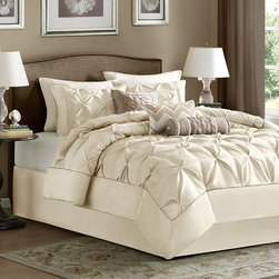 Madison Park - Madison Park Laurel 7 Piece Comforter Set - This beautifully tufted bed is from the Laurel bedding collection. Its ivory coloring makes this set easy to accessorize in your bedroom. The collection is made from 100% polyester polyoni and has pieced fabric sewn together to give this set added dimension. It is finished with a smooth edge of fabric that creates a beautiful border around this comforter.�� Comforter/Sham: 100% polyester polyoni, pieced with pleats, 100% brushed polyester reverse, 270g/m2 polyester filling Bedskirt: 100% polyester fabric drop, polyester platform Pillows: 100% polyester polyoni cover with polyester fill