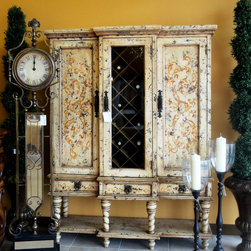 """Wine Cabinet Valery - Gorgeous French Country/Tuscan style wine cabinet that shows off your wine collection while providing hidden storage. Cabinets on each side of the piece include 2 fixed shelves for extra storage. This piece also features three drawers. Dimensions are: 64""""W x 20""""D x 82""""H."""