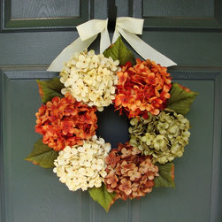 Fall Hydrangea Wreath by HomeHearthGarden - A colorful Hydrangea Wreath arrangement that makes an attractive door decoration. The wreath is handcrafted on a grapevine base with artificial hydrangea flowers and greenery with a wired fabric bow.