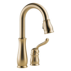 """Delta - Delta 9978-CZ-DST Leland Series One-Handle Widespread Pull-Down Kitchen Faucet - The Delta 9978-CZ-DST is a Leland Series Single-Handle Widespread Deck-Mounted Pull-Down Kitchen Faucet. This pull-down kitchen faucet features a charming teapot-inspired style that is sure to accentuate any home decor. Its pull-down spout head features Delta's exclusive MagnaTite docking to ensure a snug fit of the wand everytime. The spout has a full 360-degree turning radius, and comes with a 59"""" long hose for an extended reach. This faucet is ADA compliant, and comes in a beautiful Champagne Bronze finish."""