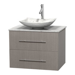 "Wyndham Collection - Centra 30"" Grey Oak Single Vanity, White Carrera Marble Top, Carrera Marble Sink - Simplicity and elegance combine in the perfect lines of the Centra vanity by the Wyndham Collection. If cutting-edge contemporary design is your style then the Centra vanity is for you - modern, chic and built to last a lifetime. Available with green glass, pure white man-made stone, ivory marble or white carrera marble counters, with stunning vessel or undermount sink(s) and matching mirror(s). Featuring soft close door hinges, drawer glides, and meticulously finished with brushed chrome hardware. The attention to detail on this beautiful vanity is second to none."