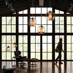 Contemporary Rustic Architecture - Farmhouse architecture with modern interiors give this space an industrial loft-like feel with a connection to nature.