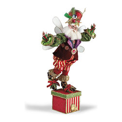 Frontgate - Mark Roberts Prince of Christmas Fairy Stocking Holder - Heirloom-quality design is a cherished collectible or thoughtful gift. Handcrafted with Mark Roberts' signature rich fabrics and expressive, handpainted face. Coordinating fabrics on the present and costume. Wired arms and legs for a customized pose. Arrives in a beautiful gift box. Layered in royal garb and jewels, our Prince of Christmas Stocking Holder will feel right at home next to your holiday finery. The handcrafted design is perfectly weighted to hold a single stocking, and showcases artist Mark Roberts' careful attention to detail. The exquisitely styled fairy wears a red fez, faux fur-rimmed boots, voluminous pants, and a tailored velvet vest with jeweled belt.  .  .  .  .  .